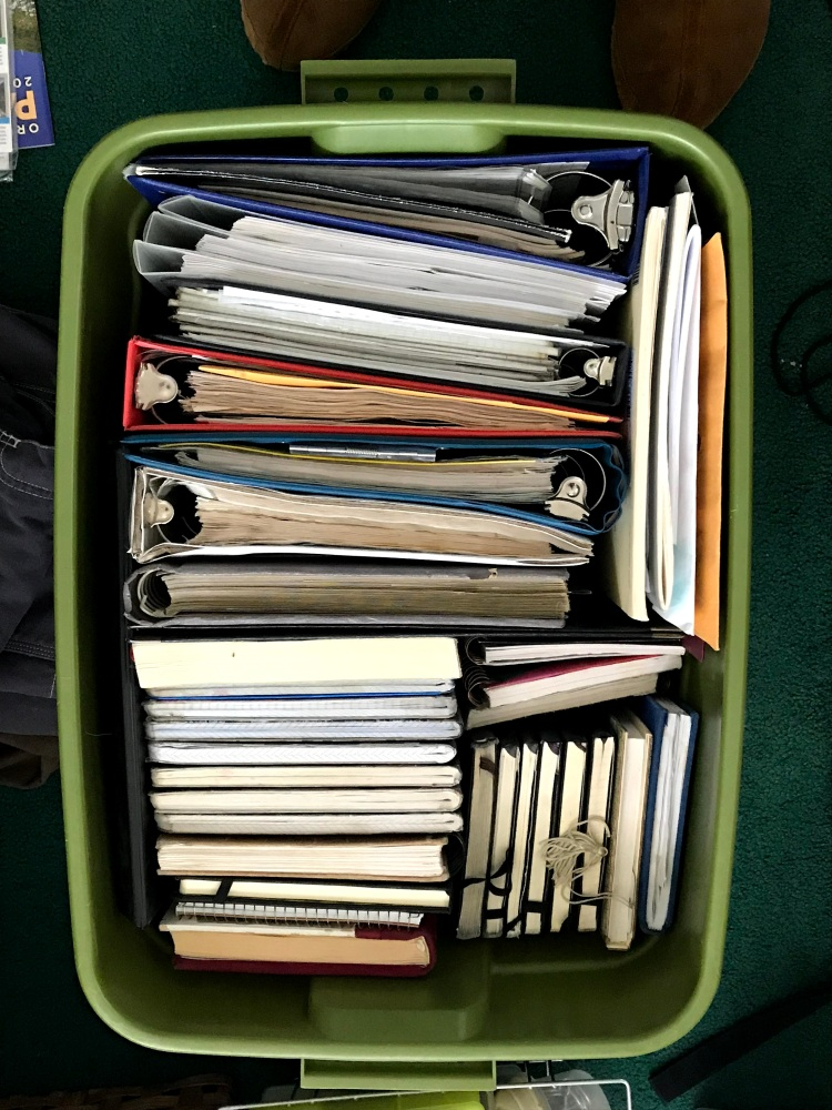 tote filled with notebooks and binders
