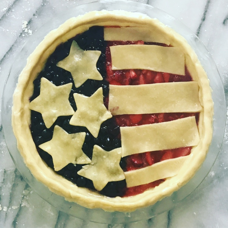 Handmade pie with stars and stripes in the crust. Half blueberry and half strawberry filling.